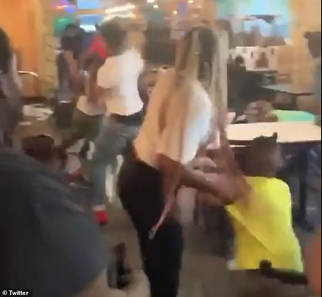 Two families had an all-out brawl in a busy Mississippi restaurant on Saturday.