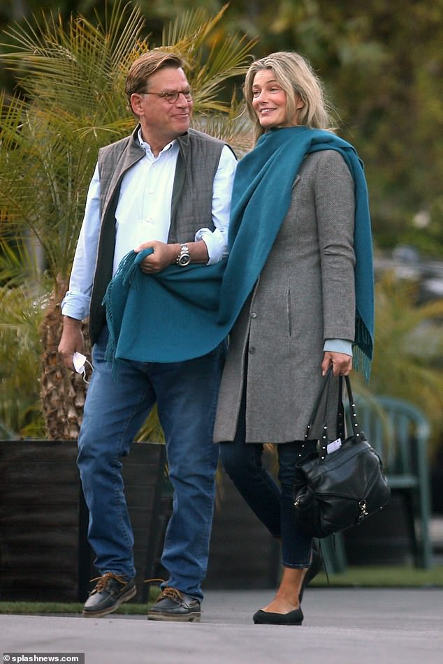 Just the two of us:Paulina Porzikova was completely smitten with boyfriend Aaron Sorkin as they packed on the PDA in the parking lot of Mel's Diner in Los Angeles on Tuesday night