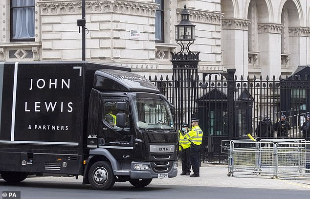 John Lewis today shared a photo of one of their delivery lorries park outside Downing Street with the caption: 'Good thing we have a recycling service for old pre-loved furniture'