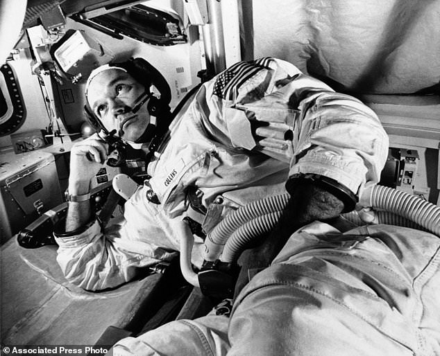 As a boy, Collins dreamed of going to space. In this June 19, 1969 file photo, Apollo 11 command module pilot astronaut Michael Collins takes a break during training for the moon mission, in Cape Kennedy.