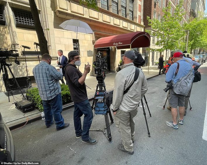 Media outside Rudy Giuliani's apartment after its raid by the feds