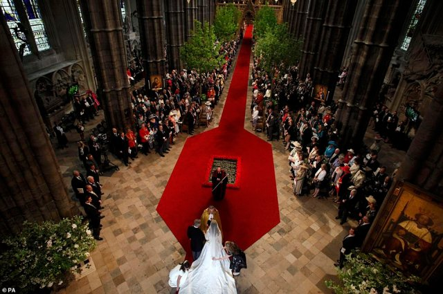 The soon-to-be-newlyweds pictured from above with the then Archbishop of Canterbury, Dr Rowan Williams, as they prepared to take their wedding vows