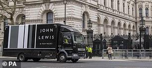 A John Lewis van passes Downing Street