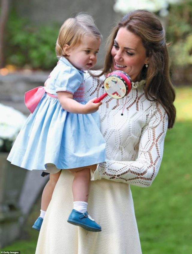 Kate looked adoringly at Charlotte during achildren's party for Military families during the Royal Tour of Canada in 2016