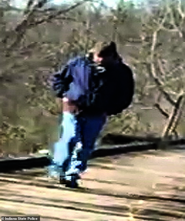The case has long focused on a man captured on camera on Libby German's phone walking along the abandoned railroad bridge on the day they went missing (pictured above)