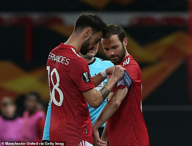 Fernandes hands the captain's armband over to Juan Mata during the home leg of the Europa League tie with Granada - a rare occasion he has been substituted off