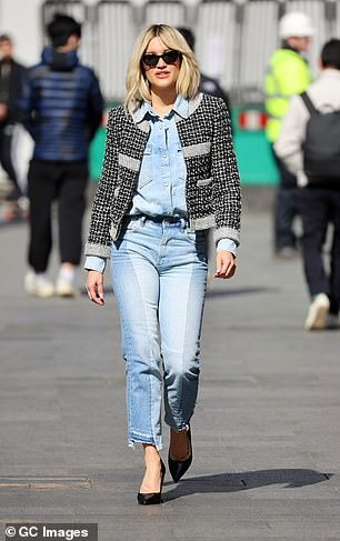 Strutting her stuff: She looked great in her work outfit