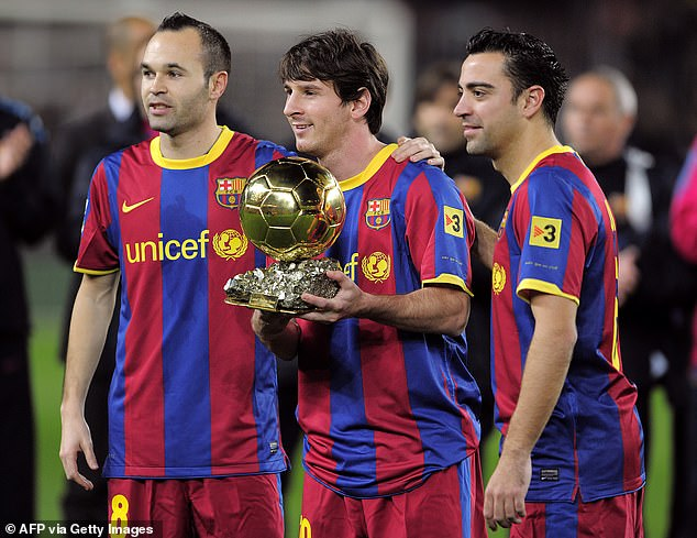 Xavi (right) formed part of the formidable Barcelona side that included Messi and Andres Iniesta (left)