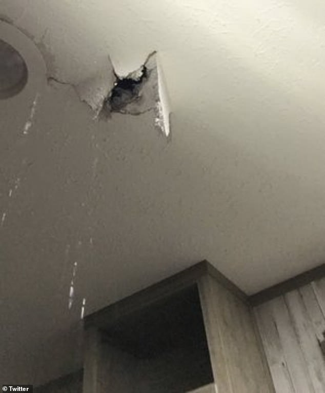 One person shared that the hailstones caused a large hole in their roof (pictured in Texas)
