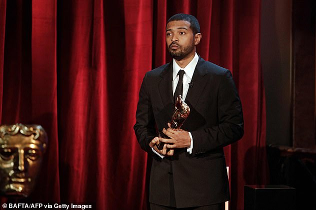 Shock: The father-of-three was suspended from Bafta following the allegations (Pictured on April 10 with his Bafta Award)