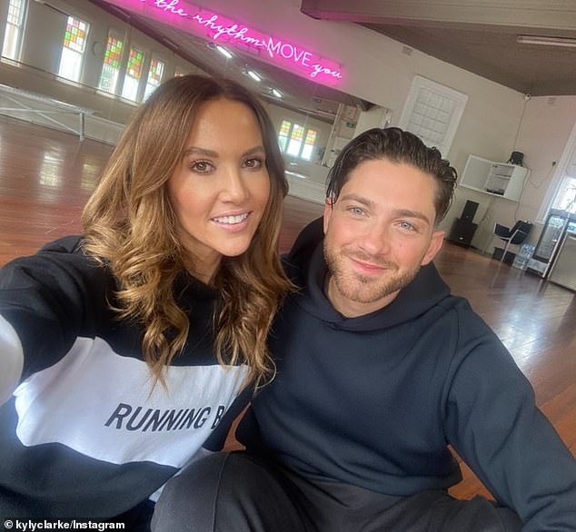 Mates:Kyly appears to have otherwise been having a ball in the company of her hunky Italian dance partner, Gustavo Viglio (right). The former WAG was beaming as the pair cuddled up for a sweet selfie earlier on Sunday