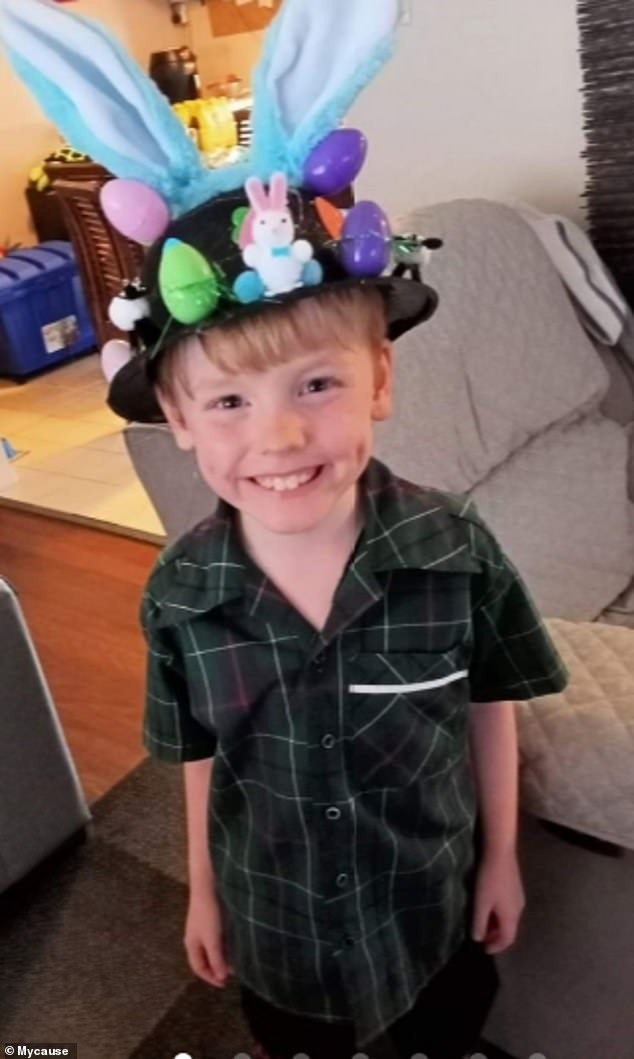 Deklan shows off his Easter bonnet wearing his Willian Duncan State School uniform