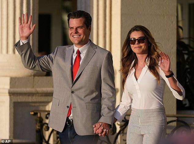 "Congressman Matt Gaetz, R-Fla., and his girlfriend Ginger Luckey enter ""Women for American First"" event, Friday, April 9, 2021"