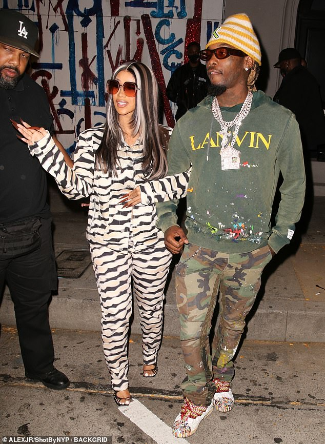 Catching the eye: WAP hitmaker Cardi, 28, caught the eye in a black-and-beige patterned trouser suit as she linked arms with her rapper partner, 29, while strolling out of the eatery