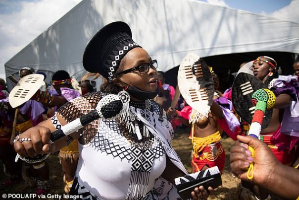 An woman leads Zulu maidens in dance during the memorial of King Goodwill Zwelithini at the KwaKhethomthandayo royal palace in Nongoma, South Africa, on March 18