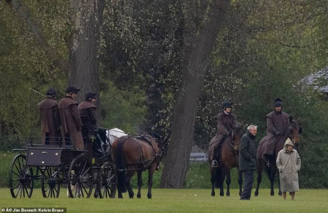 The Queen could be seen studying the Duke of Edinburgh's horses and carriages during the outing this morning