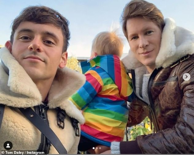 Missing out:The diver, 26, will travel to Tokyo for the sporting event in June, but Covid restrictions mean that husband Dustin Lance Black, 46, and their son won't be able to join him
