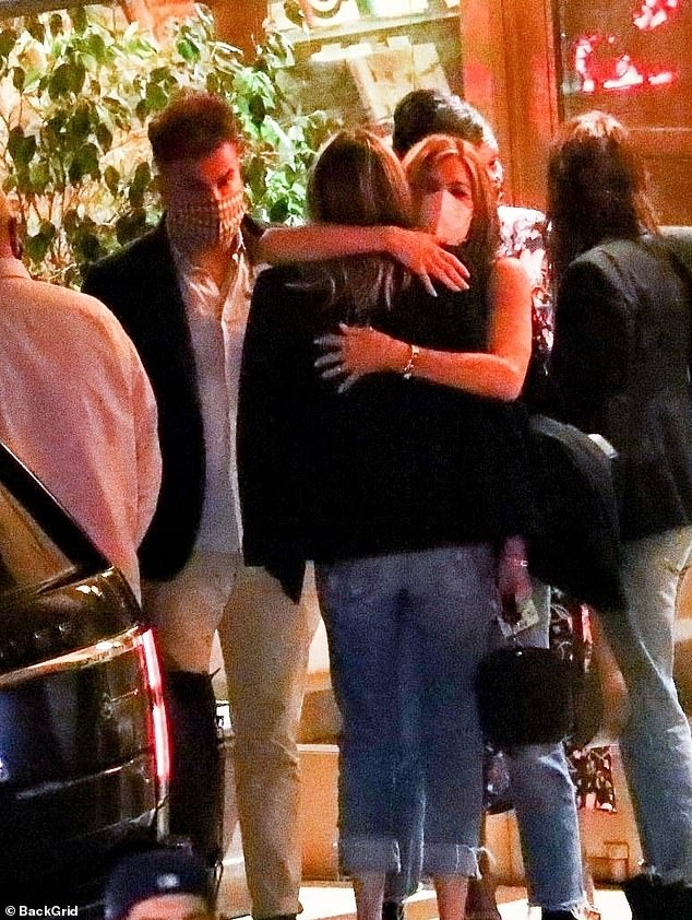 Until next time: Aniston's rumored beau Will Speck was seen nearby as she gave her pal Molly McNearney a hug outside the restaurant