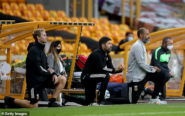 The Wolves boss (right) wants to ramp up the message on racism when fans are in stadiums