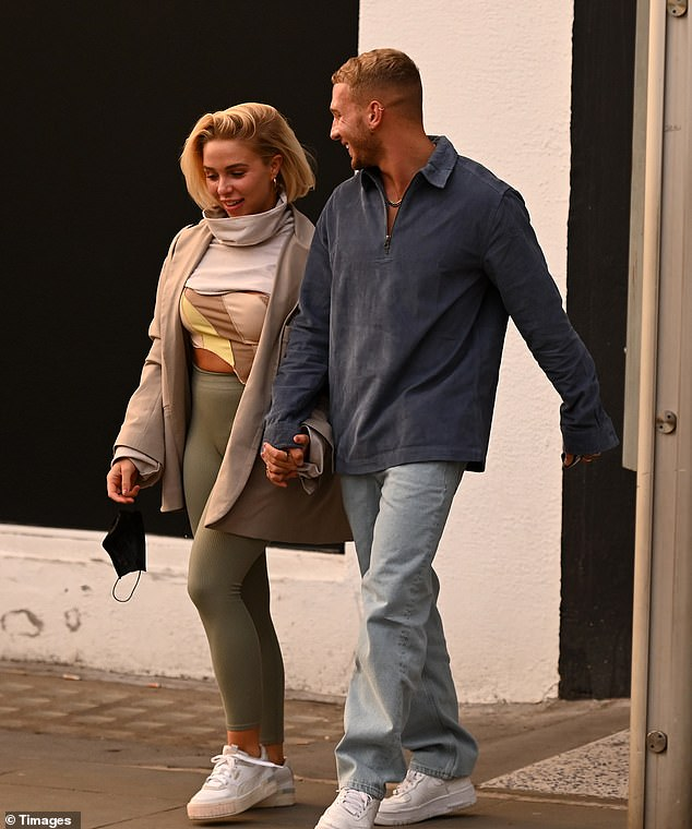 Out and about:The Love Island star, 28, cut a casually chic figure in a quirky high-neck jumper and khaki leggings as she and her beau, 24, left Young LDN salon in London's Notting Hill