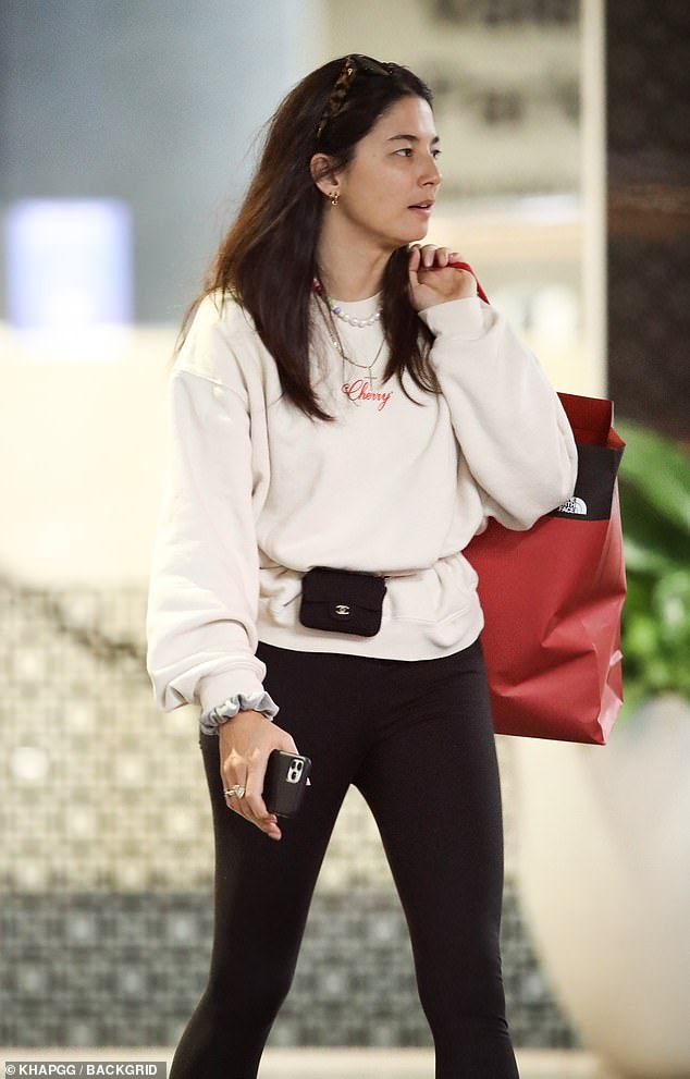 Style: The Sports Illustrated stunner looked cool and casual in a cream sweater, black leggings and a Chanel belt bag