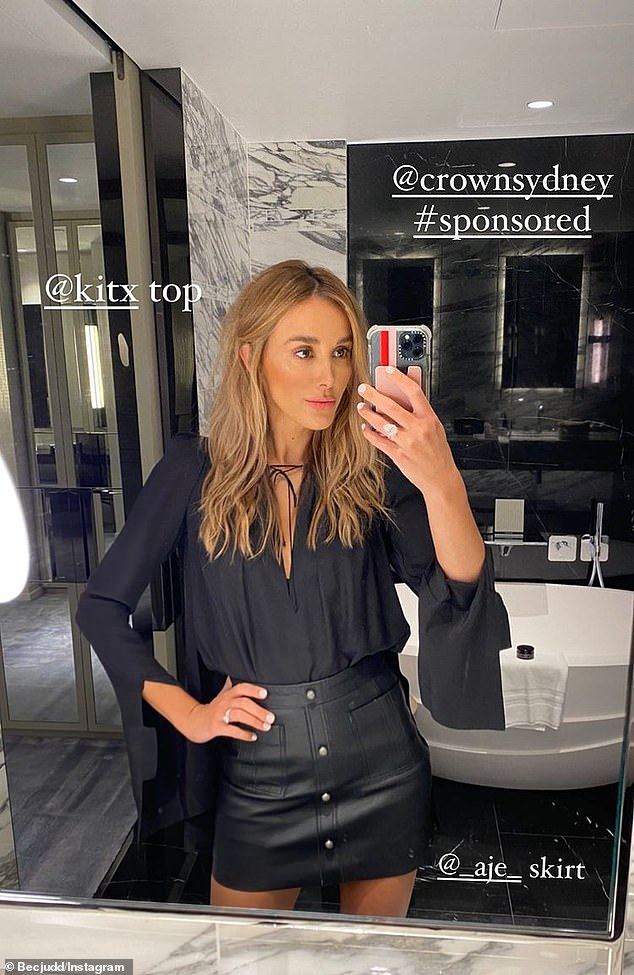 If you've got it! WAG Bec, 38, who is married former AFL star Chris Judd, opted to show off her trim pins in a leather-look miniskirt by AJE and a black KITX top