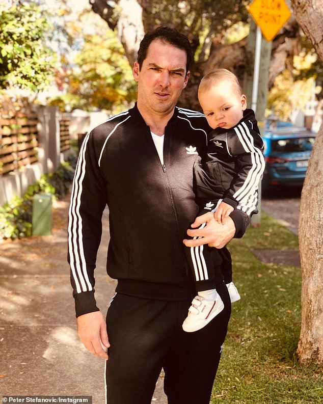 Matchy matchy:Peter, 39, showed off his black and white tracksuit in one image, which matched with son Oscar's outfit