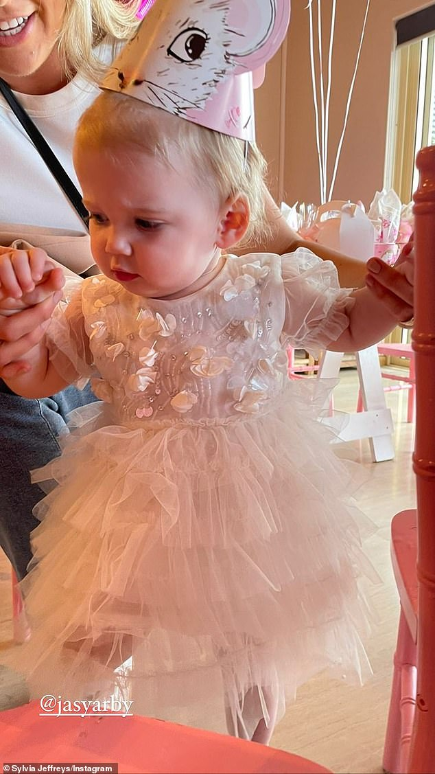 Cute!Little Harper was additionally pictured in her gorgeous white party dress complete with a tutu and a crown