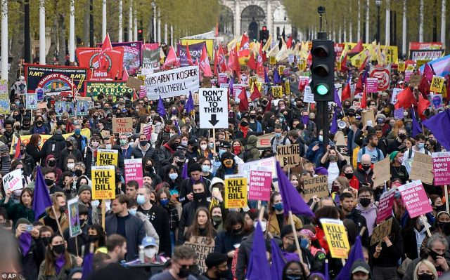 Protestors march down the Mall in central London during a 'Kill the Bill' protest on Saturday, May 1, 2021. The demonstration is against the contentious Police, Crime, Sentencing and Courts Bill. The Bill was drafted partly in response to previous disruptive action by Extinction Rebellion and also the Black Lives Matter movement.