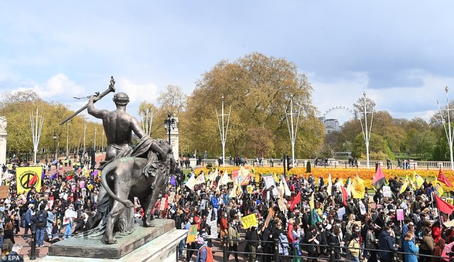 Demonstrators are seen gathering near Buckingham Palace in central London during a 'Kill the Bill' protest this afternoon