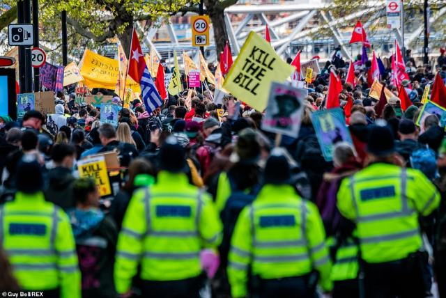 A line of police officers stand behind a crowd of Kill the Bill protestors in London earlier today as people continue to demonstrate against new legislation called the Police, Crime, Sentencing and Courts Bill