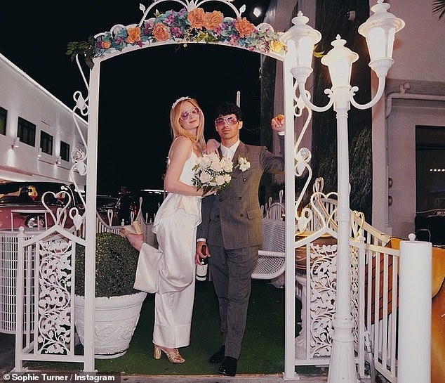 Blissful: Sophie celebrated her second wedding anniversary with Joe Jonas by posting a number of never-before-seen snaps from their surprise ceremony on Instagram on Saturday