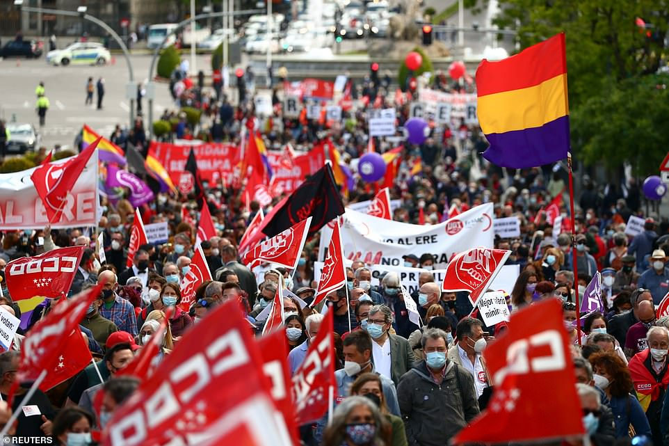 MADRID, SPAIN: Thousands pour through the streets of the Spanish capital today to mark the international workers' day