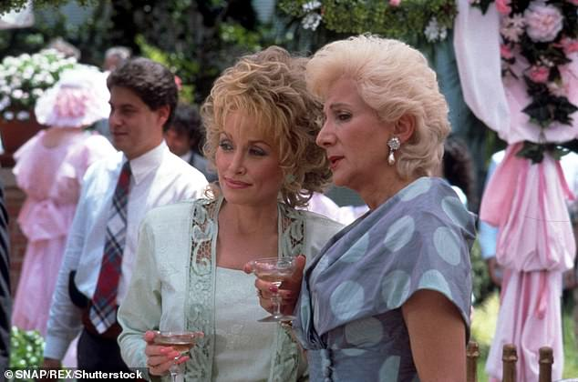 Dukakis is pictured above with Dolly Parton in the 1989 film Steel Magnolias