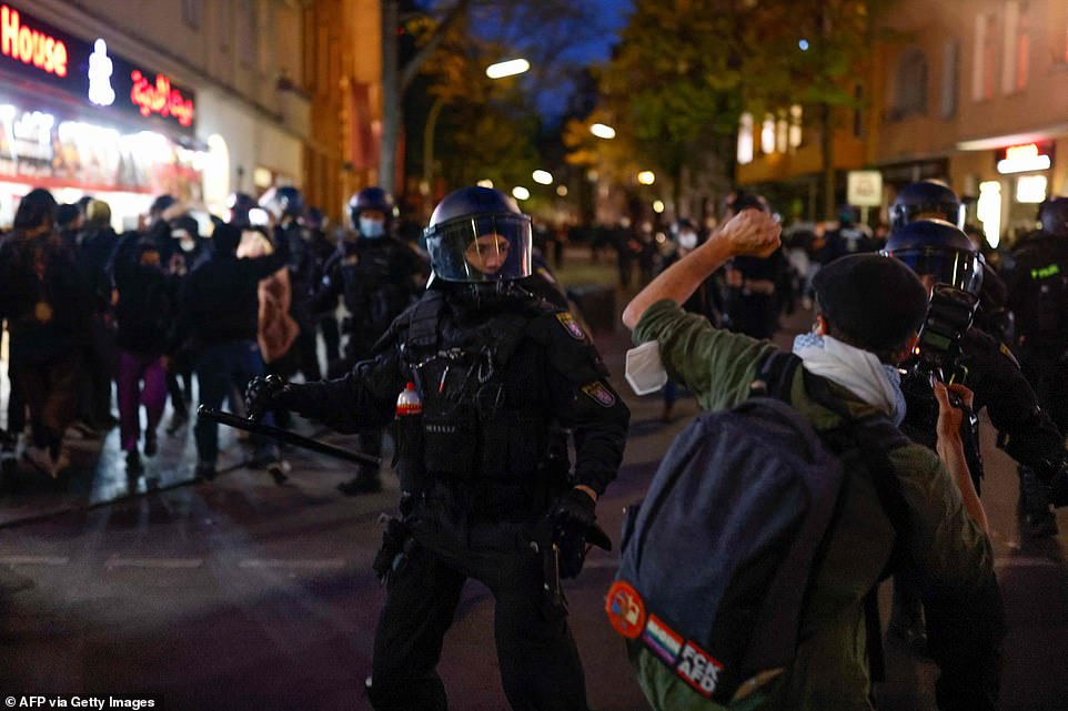 BERLIN, GERMANY: A police officer in Berlin confronts a protestor during a May day protest in the German capital this evening