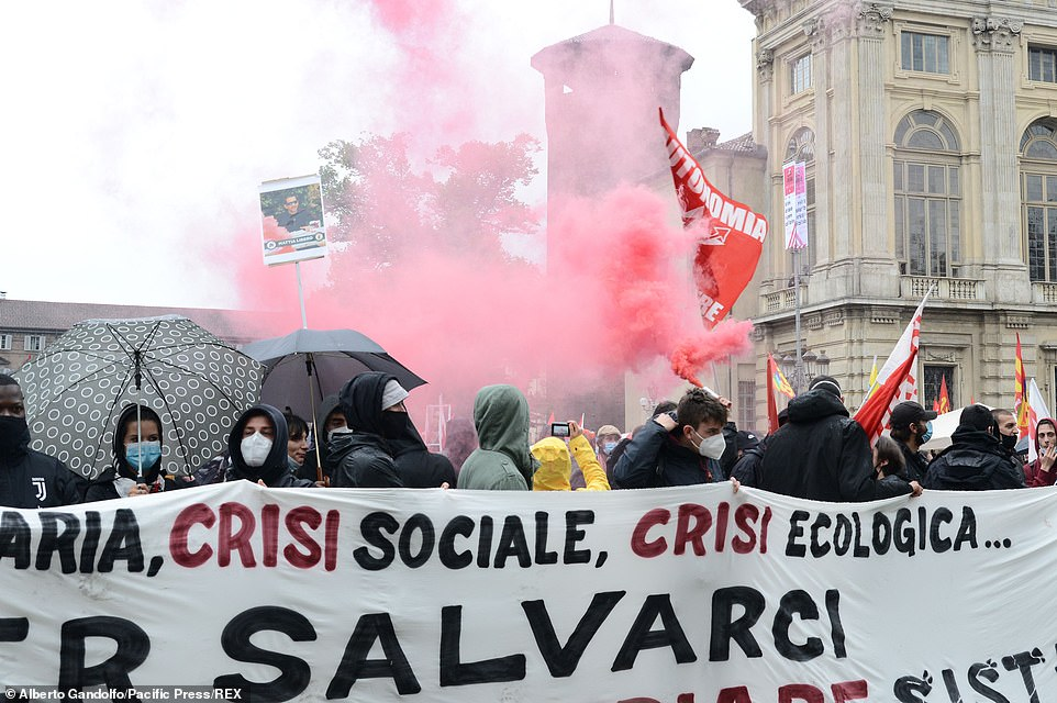 TURIN, ITALY: Red smoke fills the air above a number of demonstrators in Turin earlier today as people gathered to take part in the May Day protests