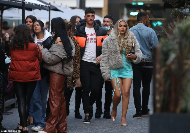 A group of people head out to enjoy their Saturday night with restrictions in the UK continuing to ease