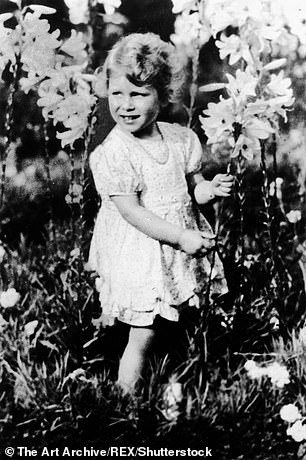 A young Princess Elizabeth was photographed playing in a field of flowers on June 3, 1930, when also aged four