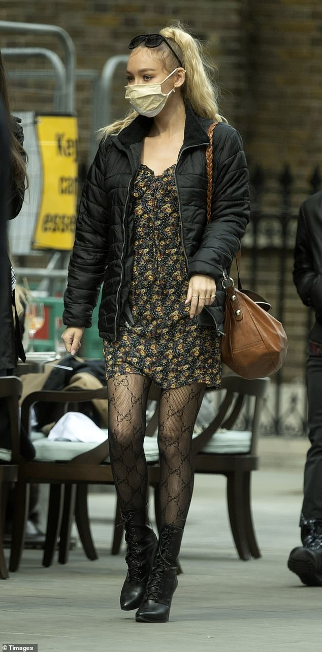 Legs 11:Keeping her look typically edgy, Roxy added a pair of pointed black heeled boots which laced up the front