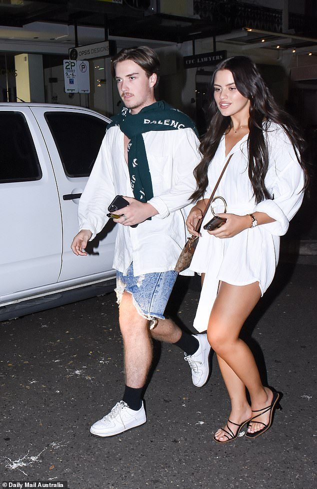 Stylish:Alistair wore a white button-up shirt which he teamed up with a pair of ripped denim shorts and white sneakers