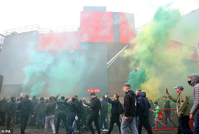 Protesting fans set off smoke flares outside Old Trafford as they make their feelings known