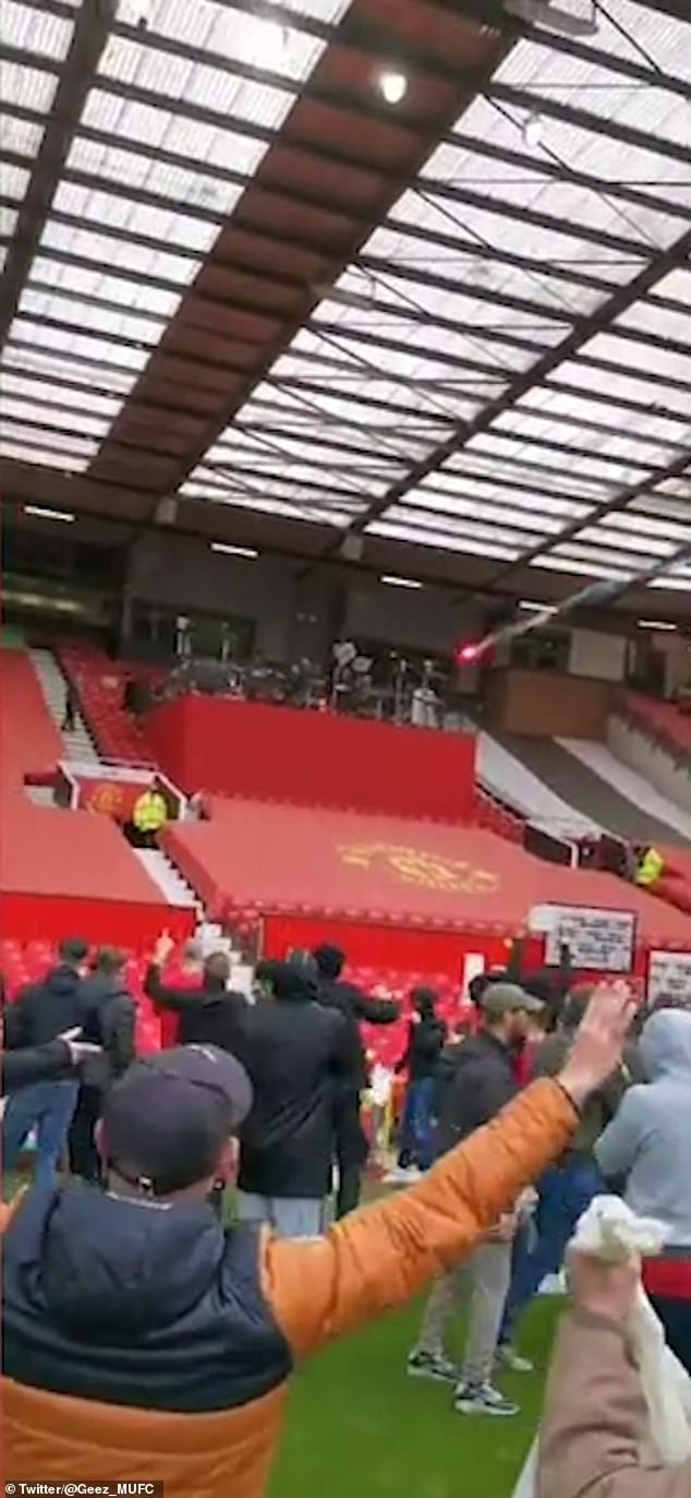 A flare was fired by the fans on the Old Trafford pitch, falling narrowly close of those in the television studio
