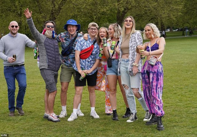 A group of revellers arrive for the music festival in Liverpool's Sefton Park today