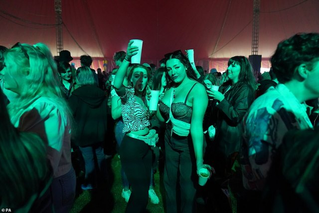Thousands of party-goers arrive to the music festival in Sefton Park in Liverpool today