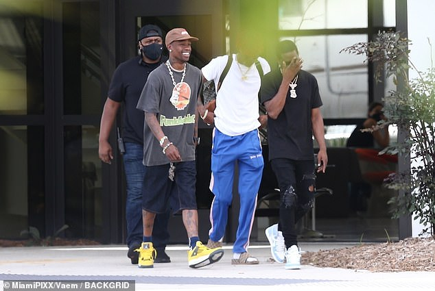 Keeping it casual: The Sicko Mode hit-maker wore a grey T-shirt, jean shorts, yellow sneakers, and a chunky necklace