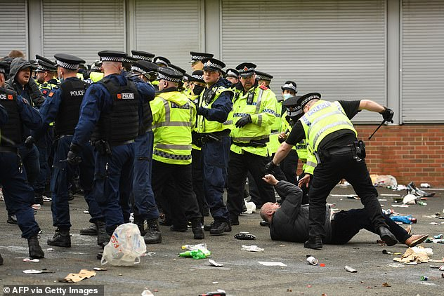 Police were forced to push back to clear the Old Trafford concourse, leaving behind a mess