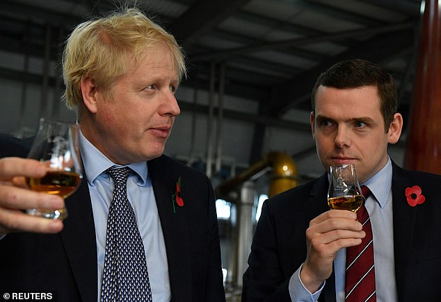 The PM is pictured together with Douglas Ross on a visit to Elgin, Scotland in the 2019 election campaign