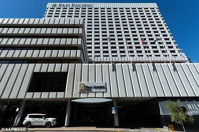 A guard in his 20s who worked at the Pan Pacific Hotel (pictured) between April 24 and 26 tested positive for Covid-19 alongside his two mates