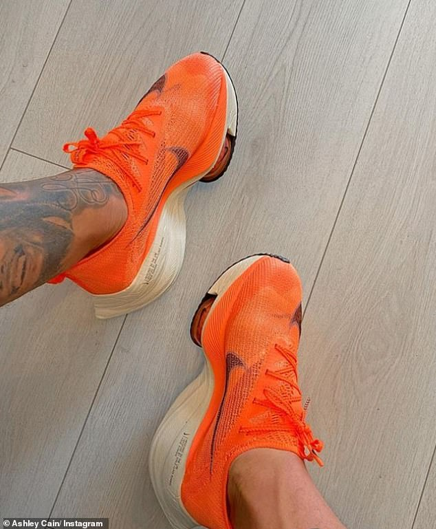 Difficult:Sharing a photo of a new pair of orange running trainers, Ashley admitted although 'things won't get easier' he is taking inspiration from Azaylia and forcing himself to 'get up'