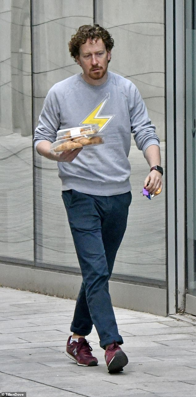 Stocking up?Nigel opted for a casual grey jumper emblazoned with a yellow lightning symbol as he grabbed a box of croissants during his outing